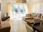 Three-bedroom garden apartments in a beach complex. Twice below the market value!