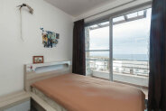 Two-bedroom penthouse in a seaside complex at price 33% below the market value