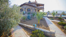 One of its kind! A stone villa with a big garden